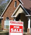 Local foreclosures edge down